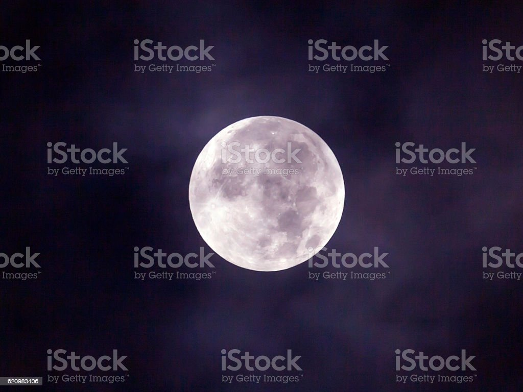 Close up of full moon in cloud stock photo