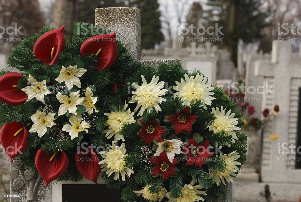 Close up of funeral flowers in the graveyard stock photo