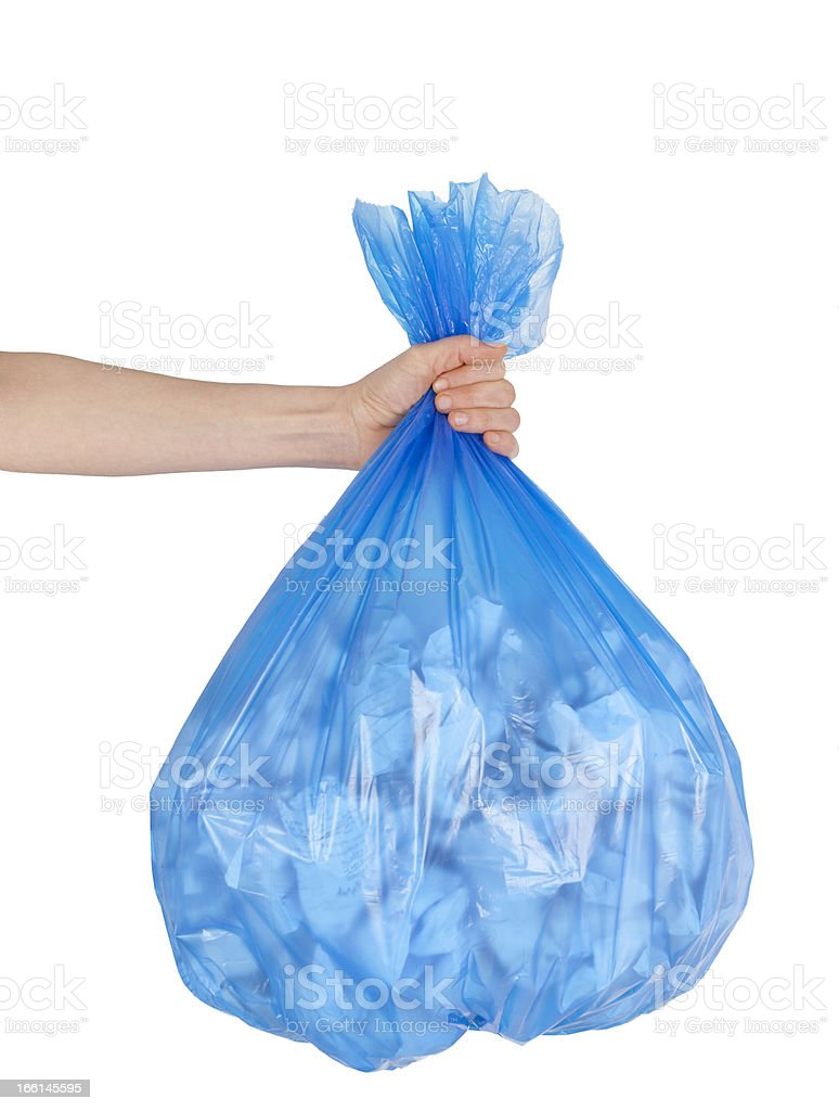 Close up of garbage bag holding by hand royalty-free stock photo