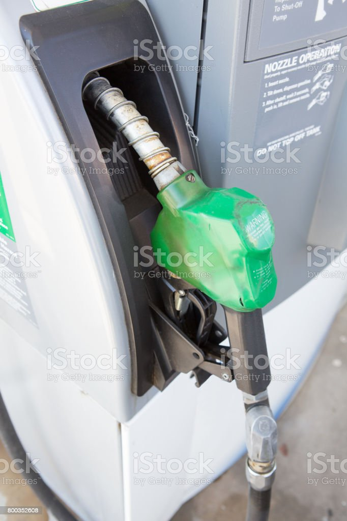 close up of gasoline hose at gas station stock photo