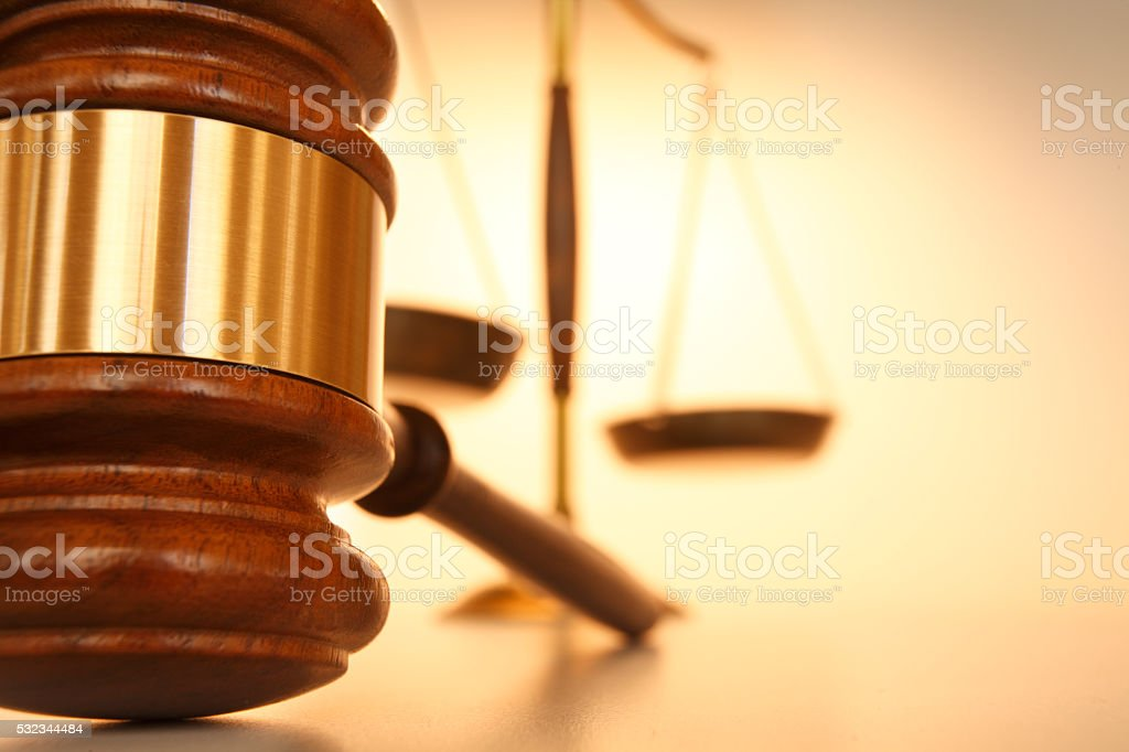 Close Up Of Gavel With Justice Scale In Background stock photo
