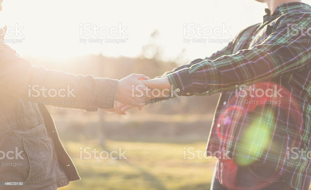 Close up of Gay couple holding hands outdoor stock photo