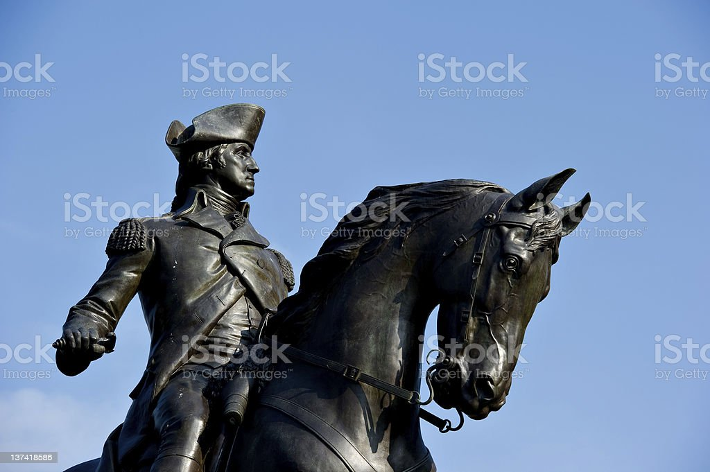 Close up of George Washington statue against the blue sky stock photo