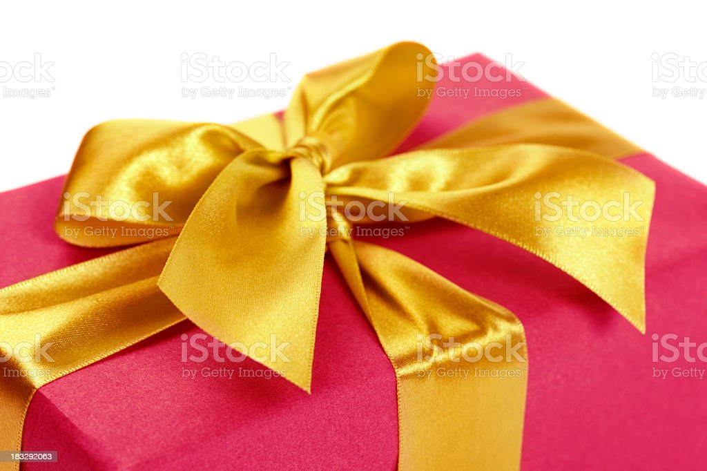 Close up of gift box with golden ribbon stock photo