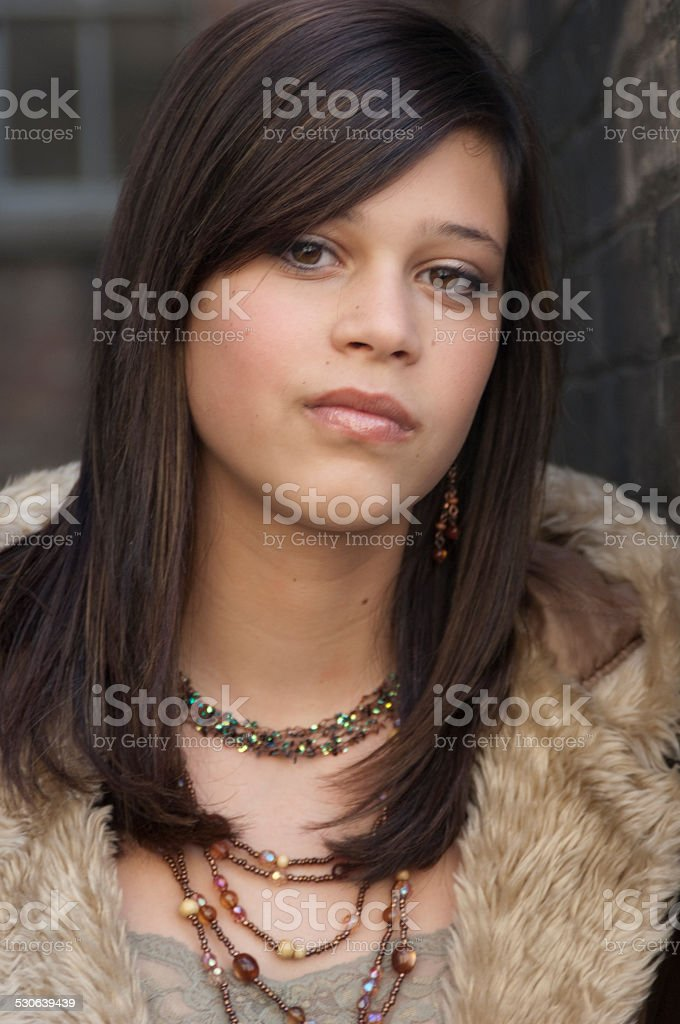 Close up of Girl in Fur Lined Coat stock photo