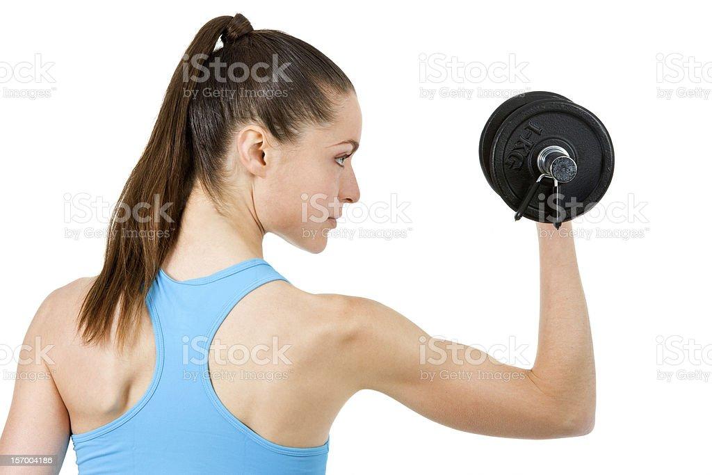 Gros plan de jeune fille en train de soulever des poids. photo libre de droits