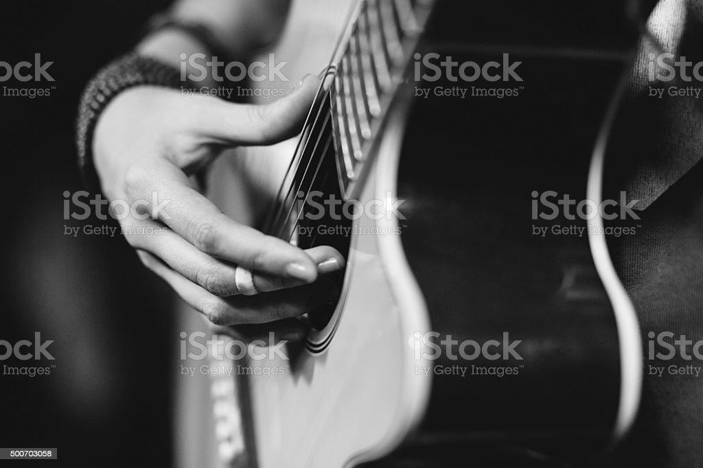 Close up of girl playing a guitar stock photo