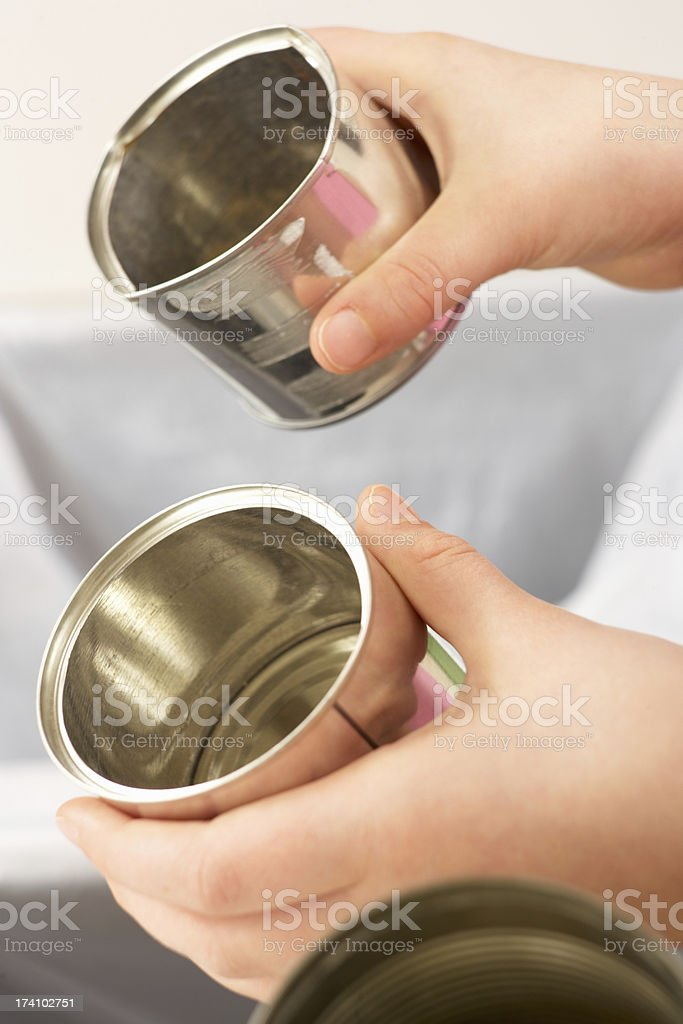 Close Up Of Girl Recycling Waste At Home royalty-free stock photo