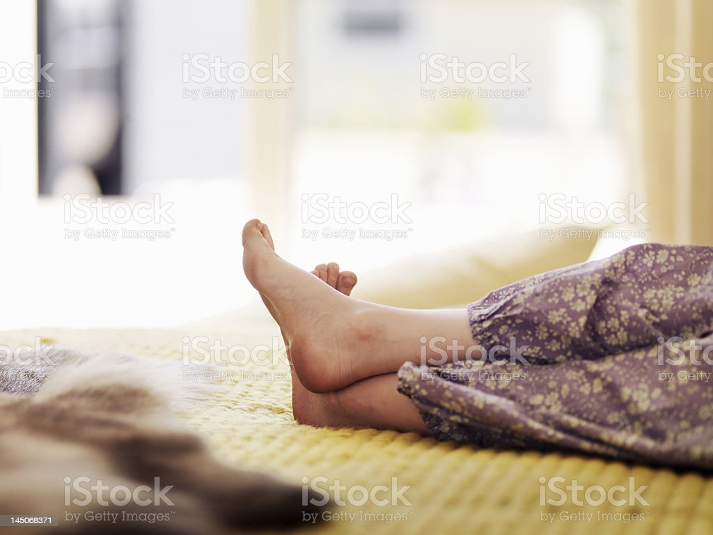 Close up of girls feet on bed stock photo