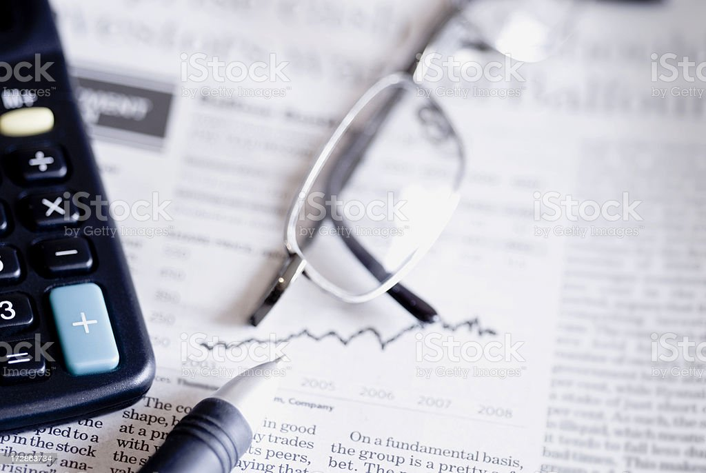 Close up of glasses on top of business papers royalty-free stock photo