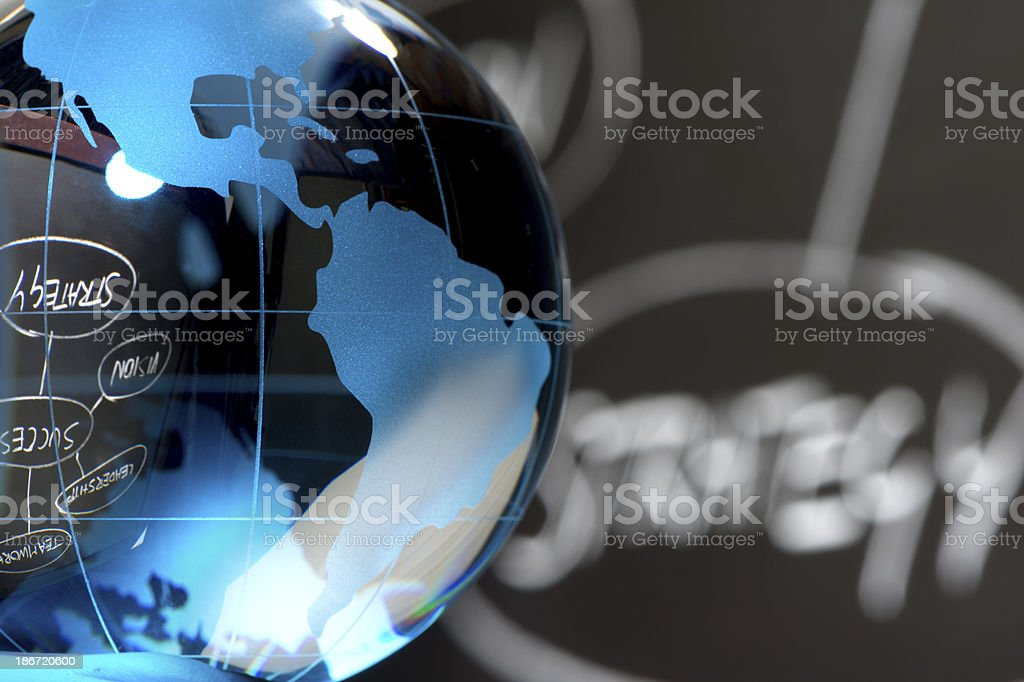 Close up of globe with strategy chart royalty-free stock photo