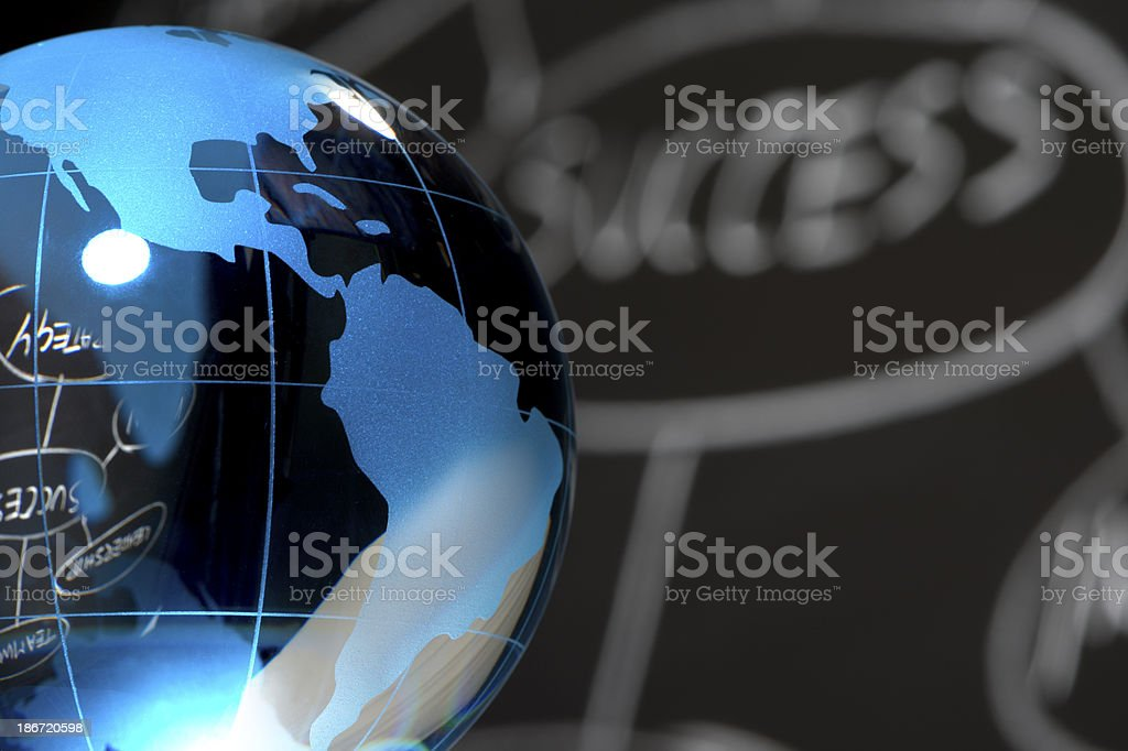 Close up of globe with success chart royalty-free stock photo