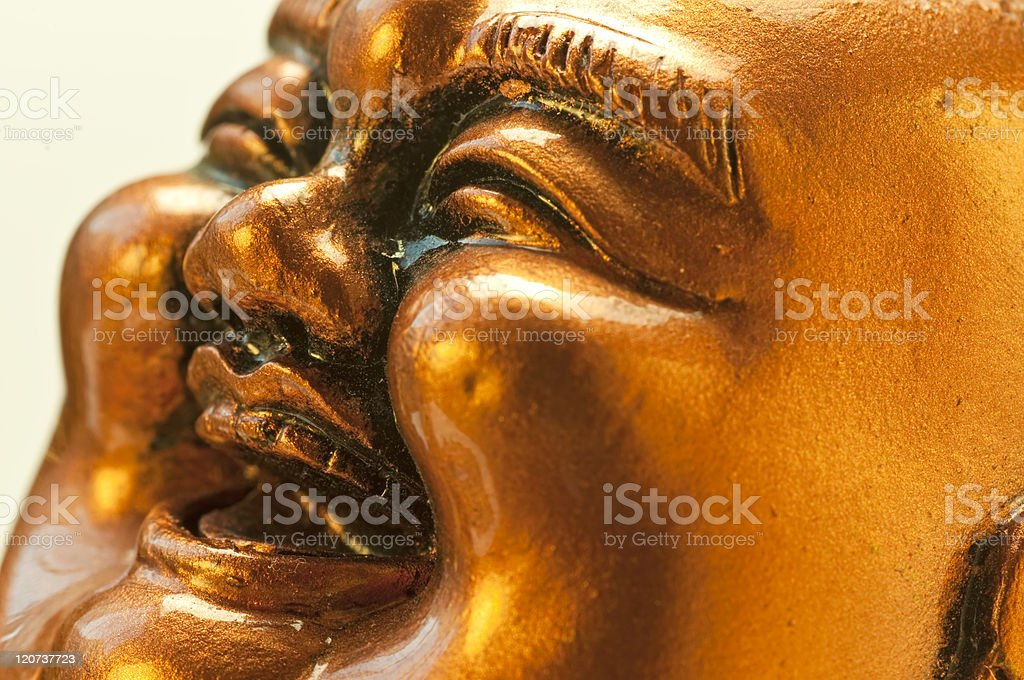 Close up of gold Buddha statue laughing stock photo