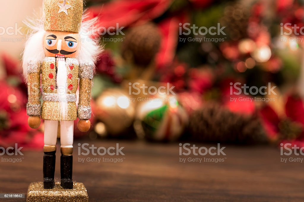 Close up of gold Christmas nutcracker ornament, decorations with copyspace. stock photo