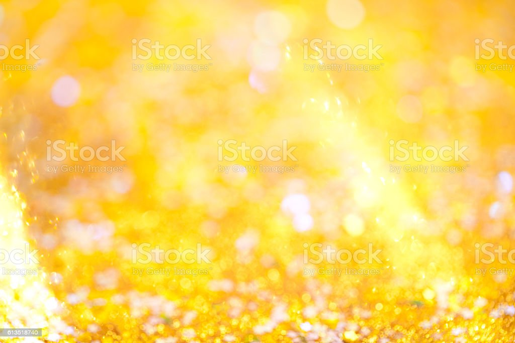 Close up of gold glitter with real sun beam. This file is cleaned and...