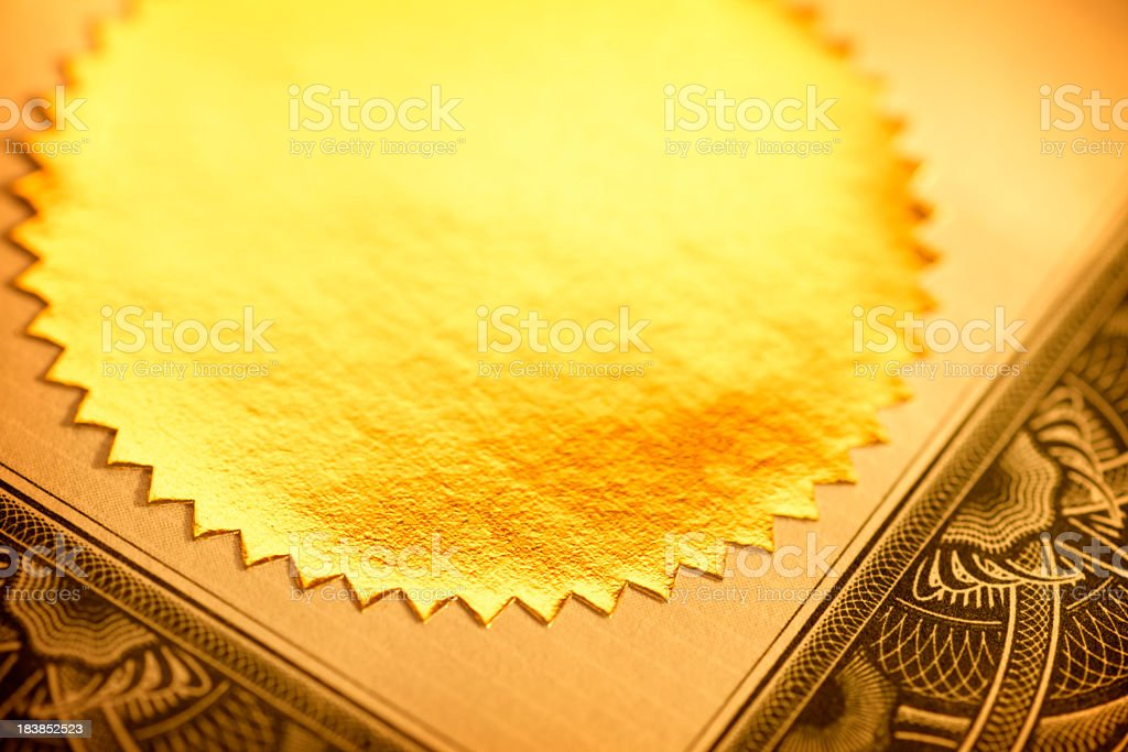 Close up of gold seal on a certificate stock photo