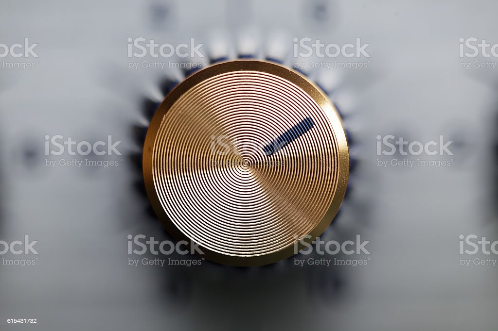 close up of golden knob guitar amplifier stock photo