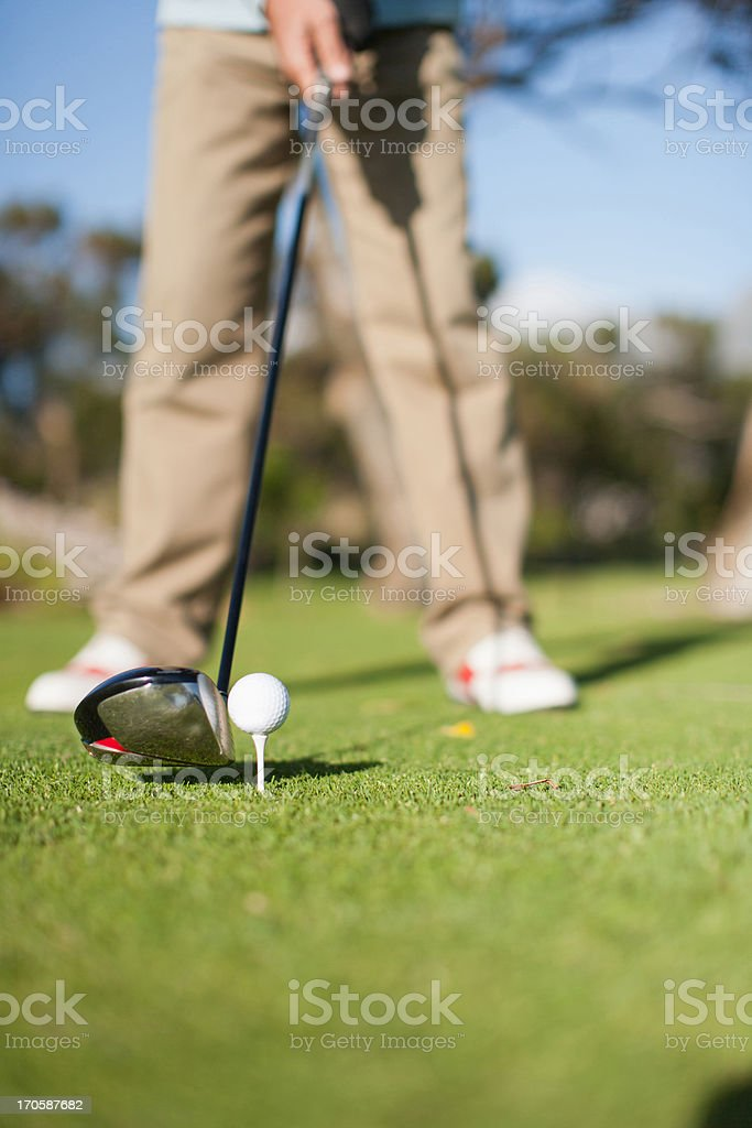 Close up of golf club about to hit golf ball royalty-free stock photo