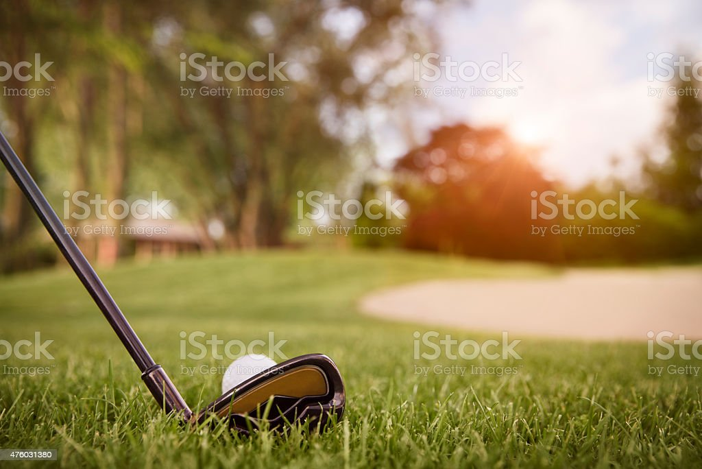 Close up of golf club and ball. stock photo