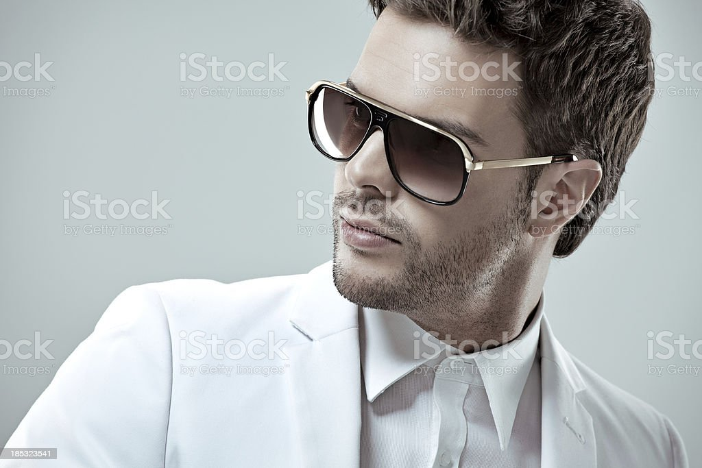 close up of good looking man wearing sunglasses stock photo