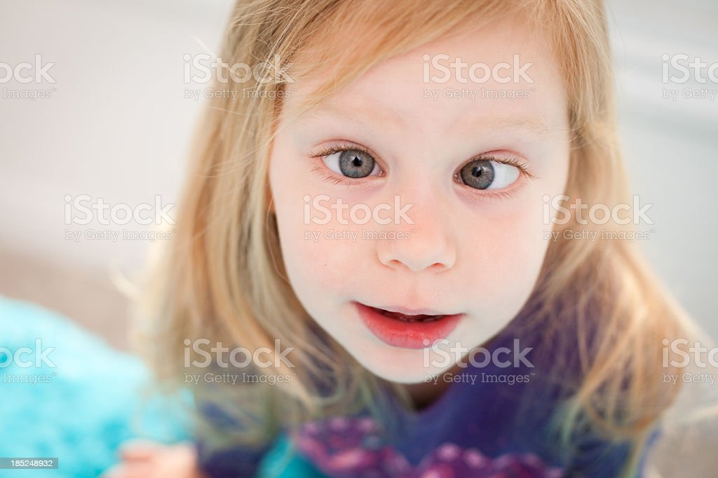 Close Up of  Goofy Little Girl Crossing Her Eyes royalty-free stock photo