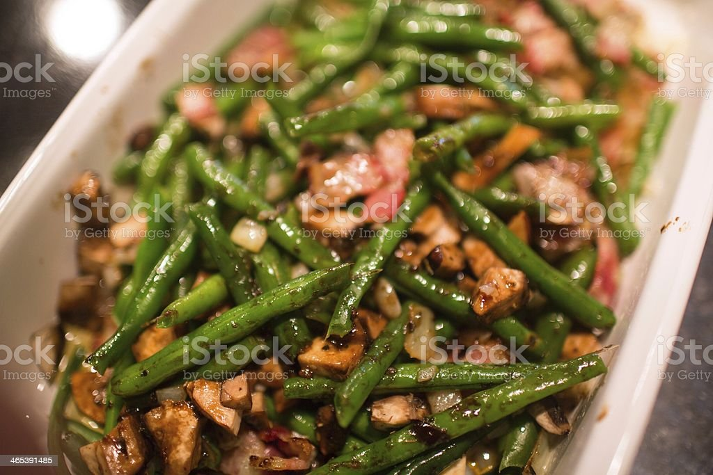 close up of green beans in casserole tray stock photo