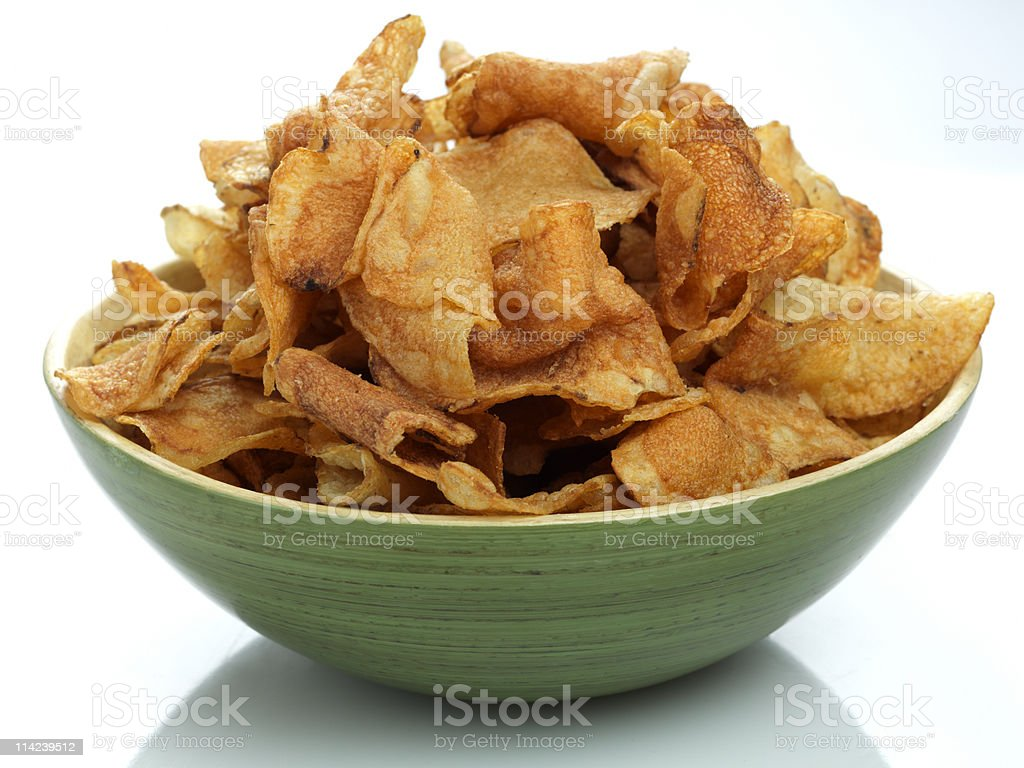 Close Up of Green Bowl Full of Potato Chips stock photo