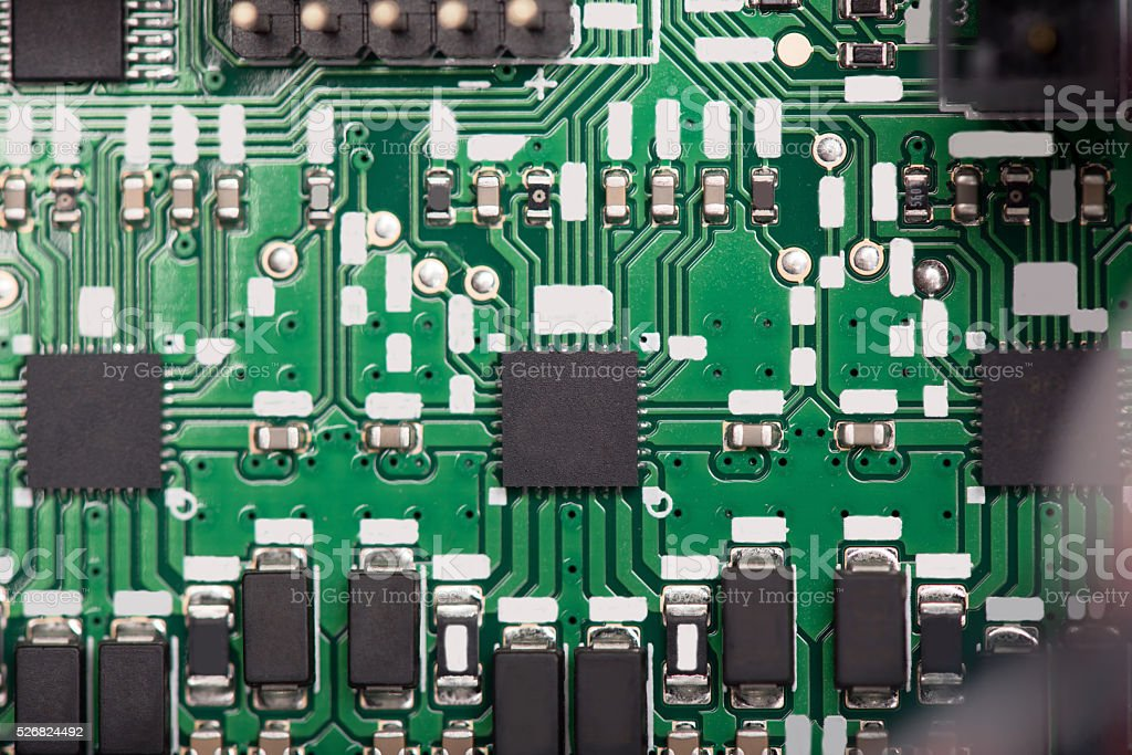Close up of green system board with microchips stock photo