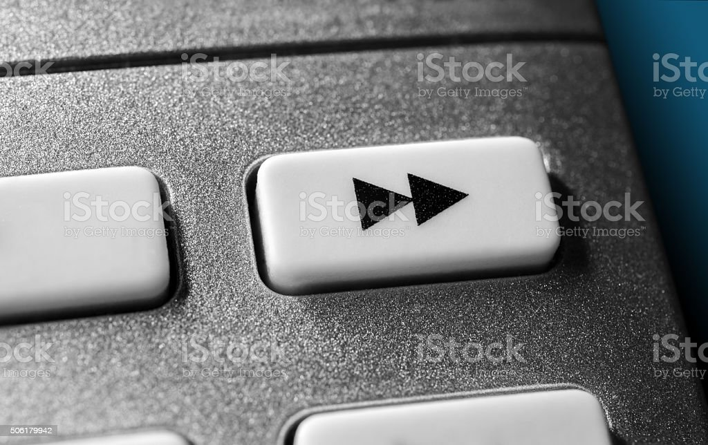 Close Up Of Grey Fast Forward Button On Remote Control stock photo