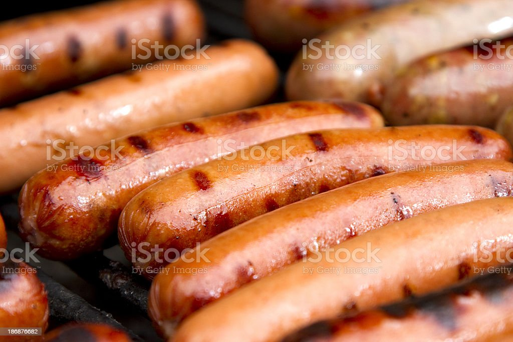 Close up of grilled hotdogs on grill stock photo