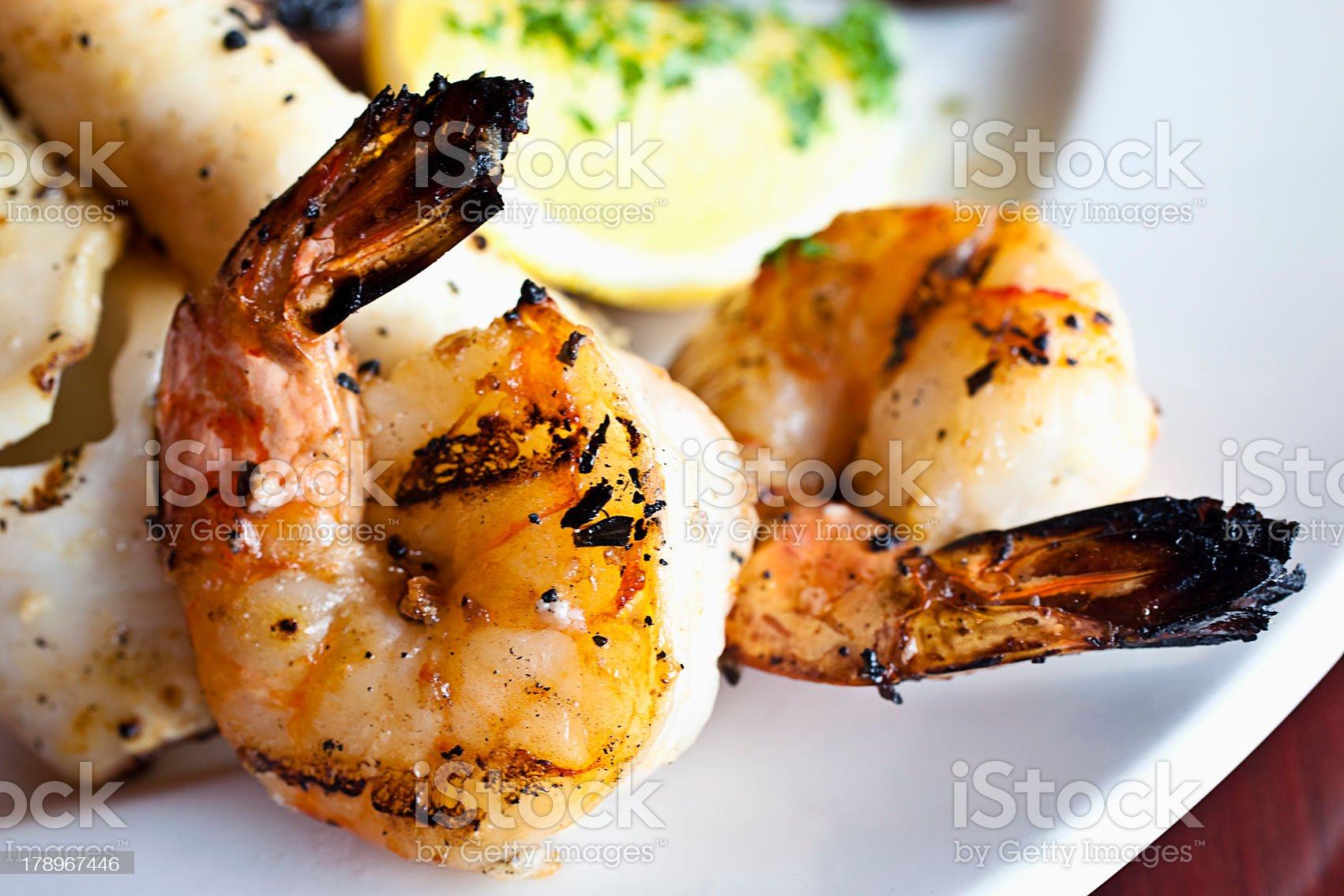 Close up of grilled shrimp on a plate royalty-free stock photo