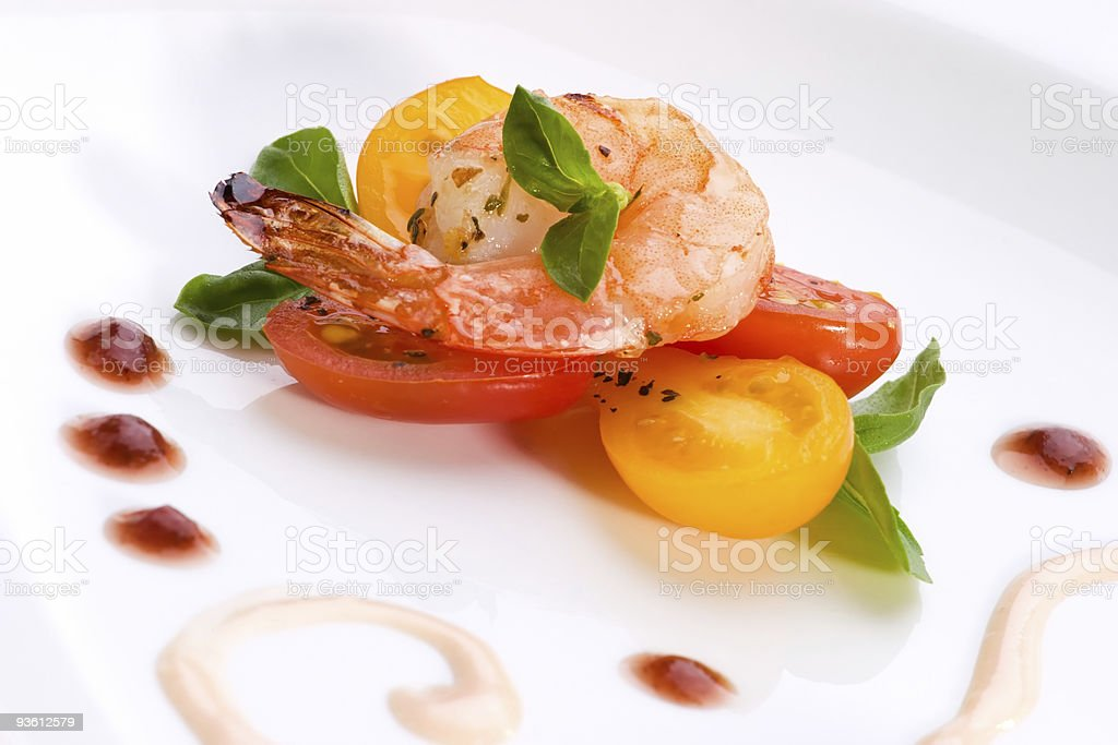 Close up of grilled shrimps on white plate royalty-free stock photo
