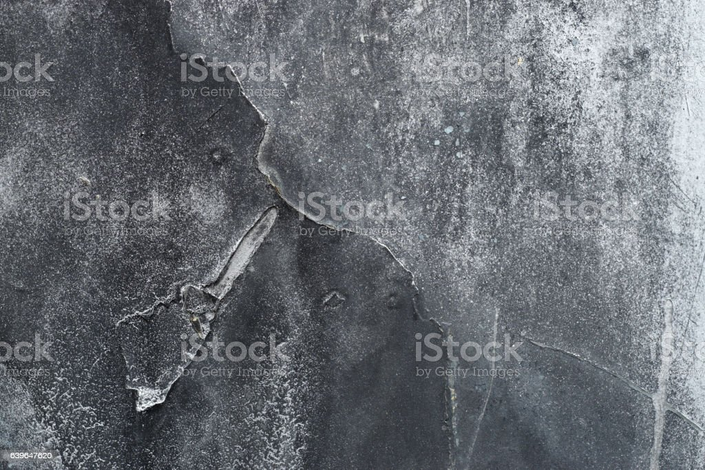 Close up of grungy rough scratched grey metal background stock photo