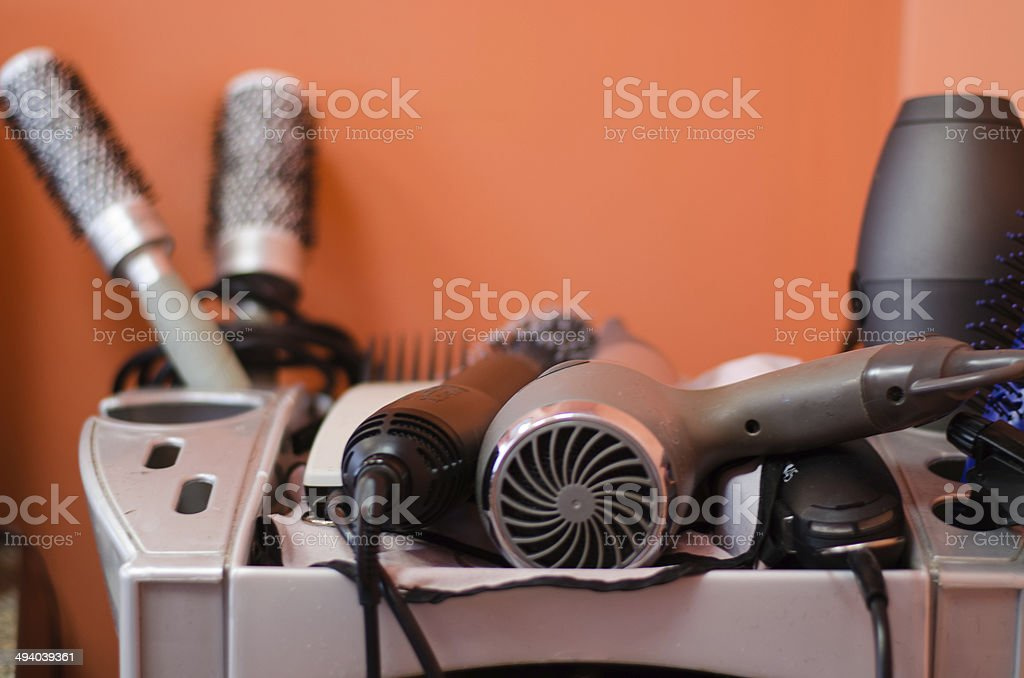 close up of hairdressing accessories in gray shelf royalty-free stock photo