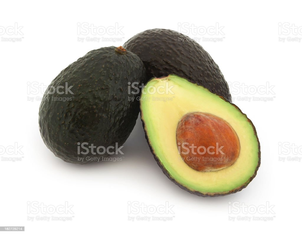 Close up of half an avocado with two whole avocados royalty-free stock photo