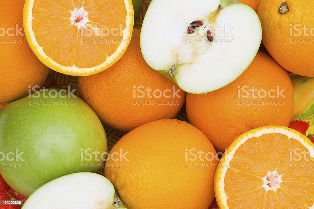 Close up of half cut oranges and apples royalty-free stock photo