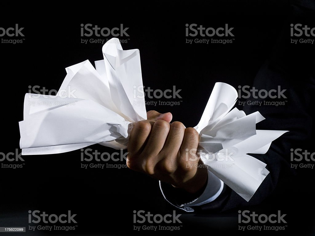 Close up of hand crushing a paper royalty-free stock photo