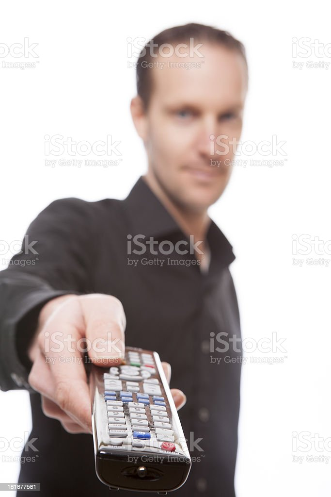 Close up of hand holding a remote control royalty-free stock photo
