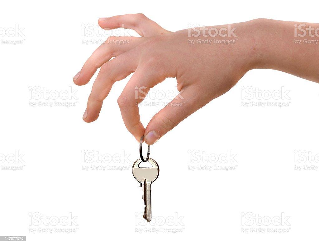 Close up of hand holding key isolated on background royalty-free stock photo