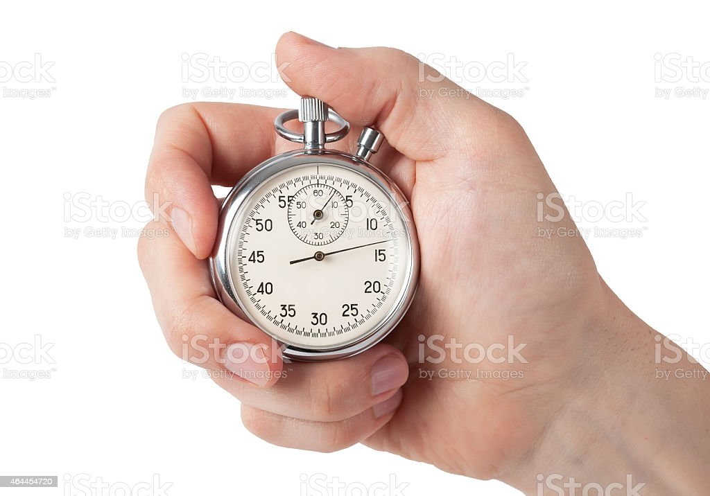 Close up of hand holding stopwatch, isolated on white background stock photo