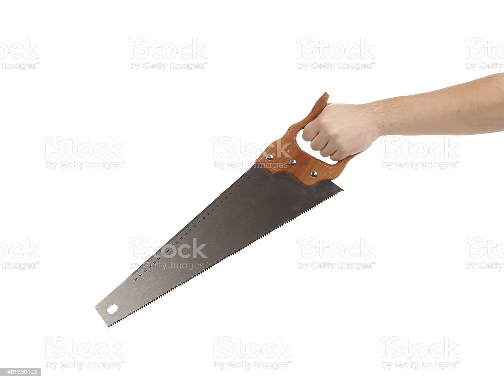 Close up of hand in gloves with saw. stock photo