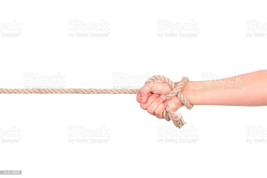 close up of hand pulling a rope stock photo