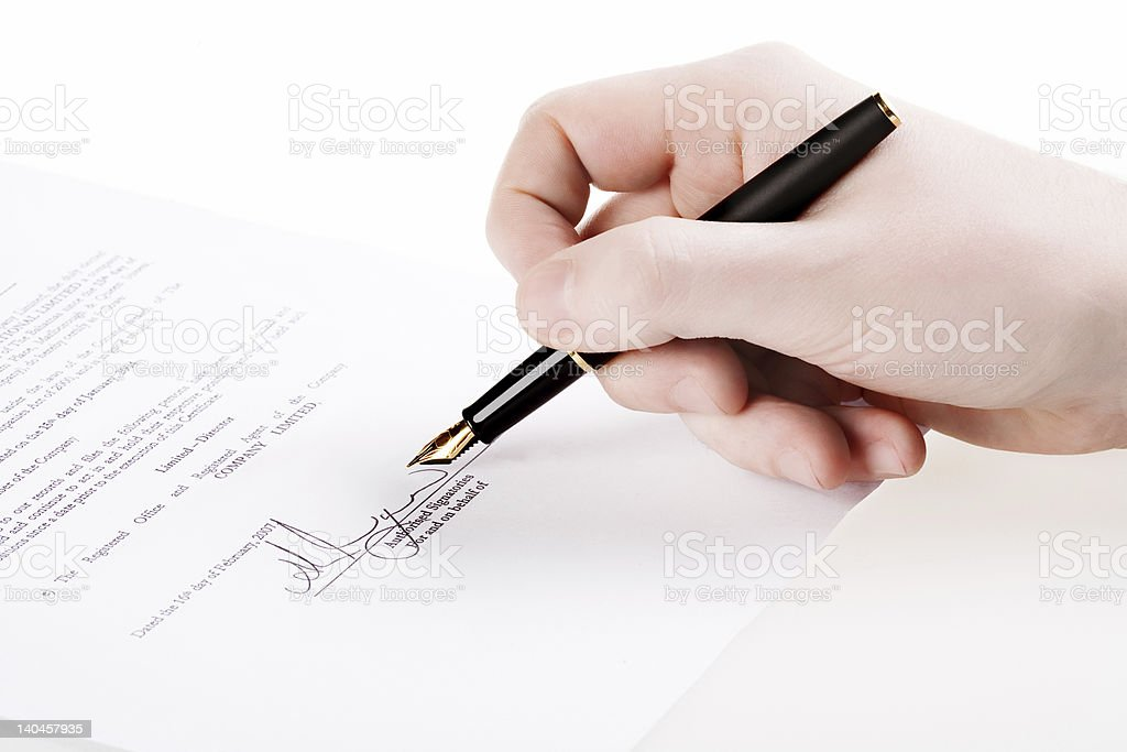 Close up of hand signing a document. royalty-free stock photo