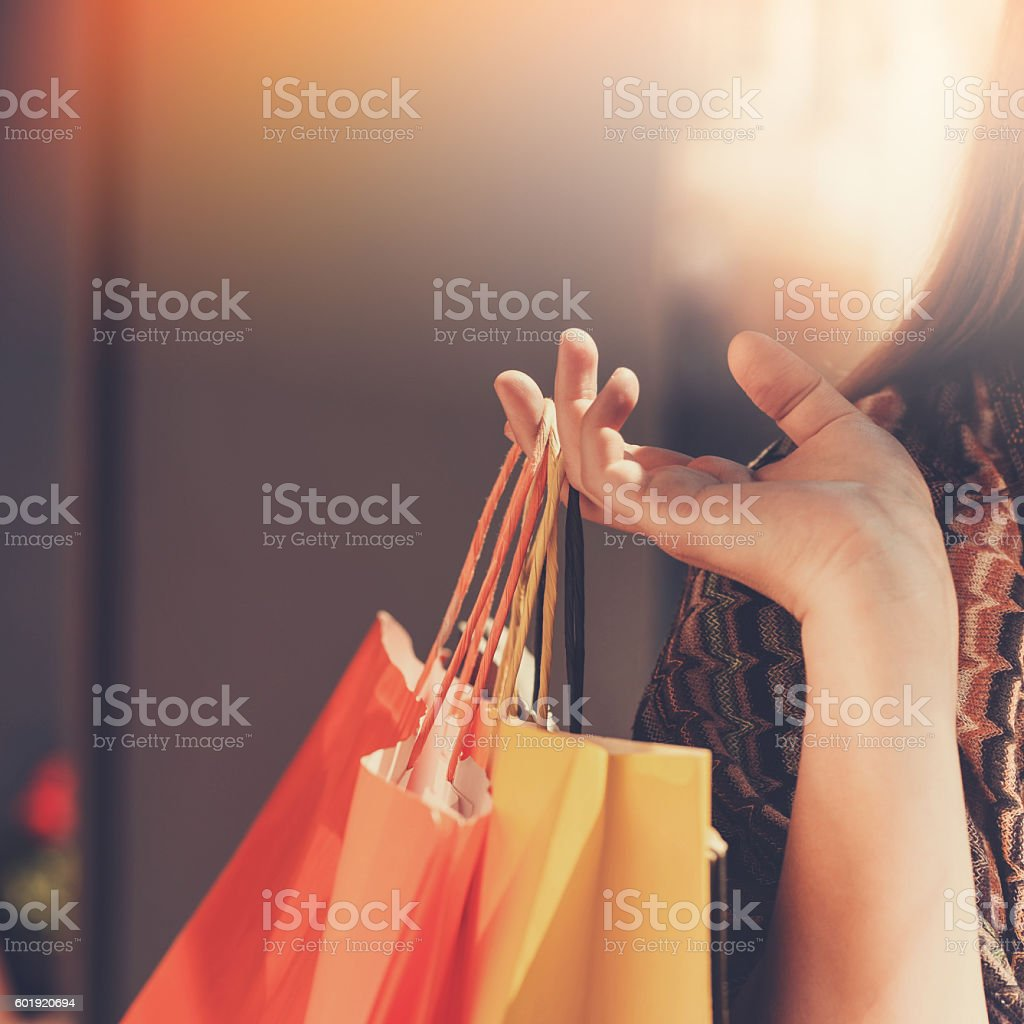 Close up of hand with shopping bags stock photo