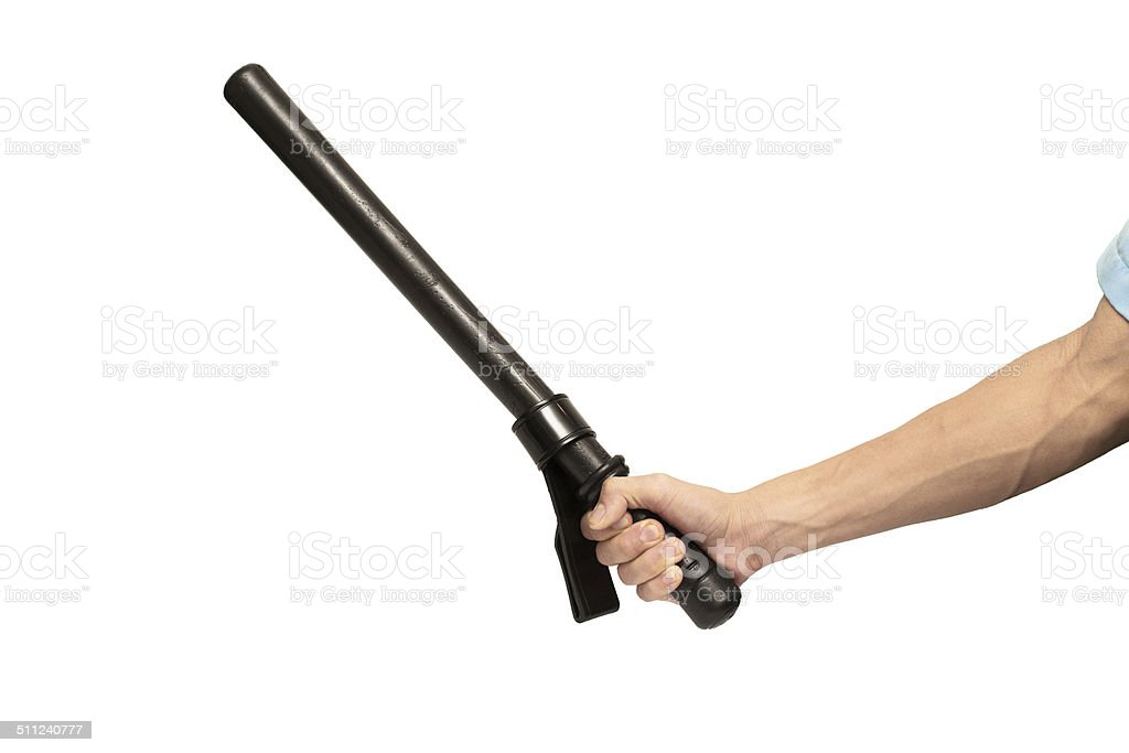 Close up of hand with truncheon. stock photo