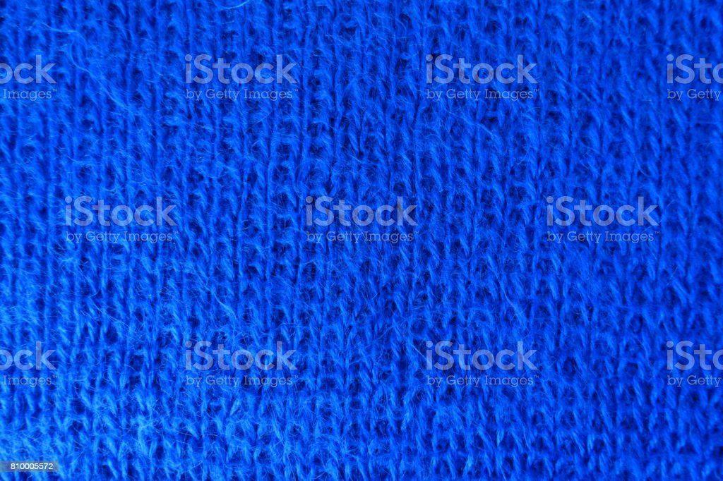 Close up of handmade blue knit fabric stock photo