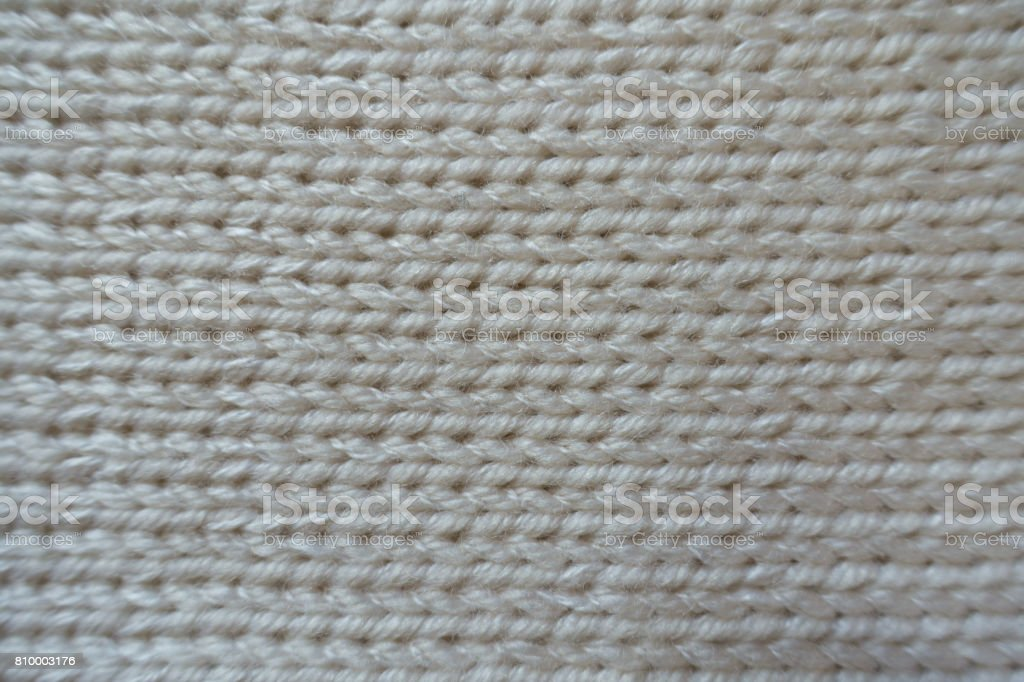Close up of handmade ivory stockinet textile from above stock photo