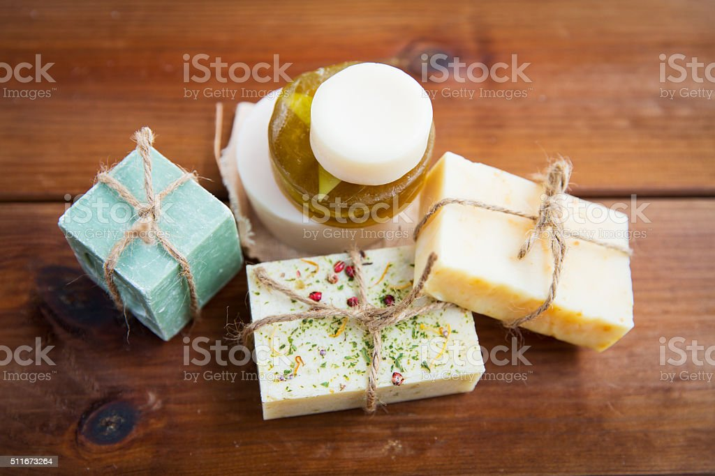 close up of handmade soap bars on wood stock photo
