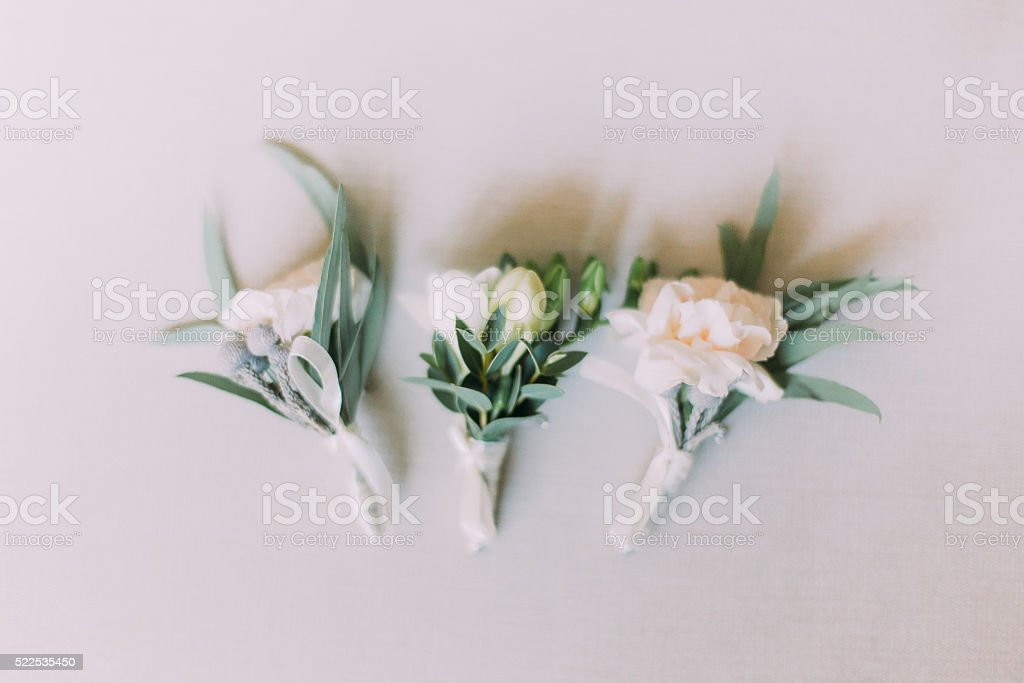 Close up of handmade wedding floral accessory. Decoration for hands stock photo