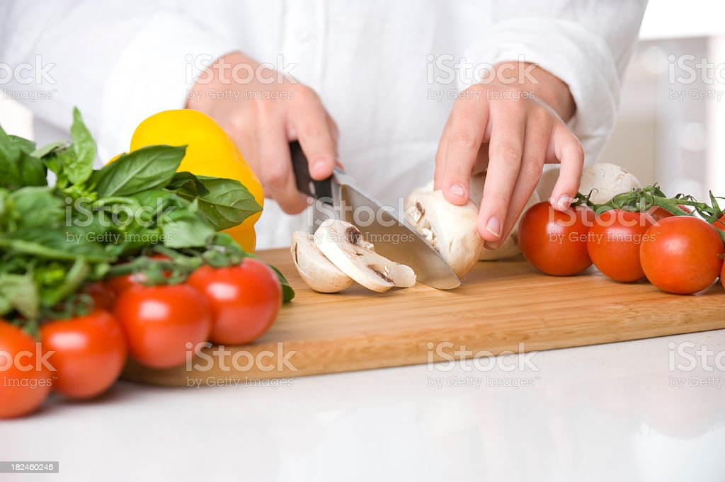 close up of hands chopping food royalty-free stock photo